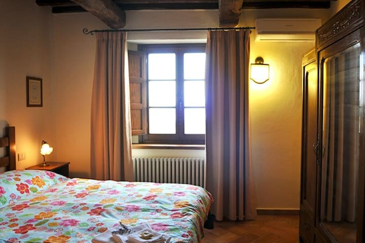 The cosy double bedroom has antique furniture and furnishings created by local artisans