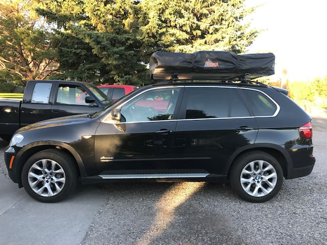 BMW X5 with the tent down; in drive mode