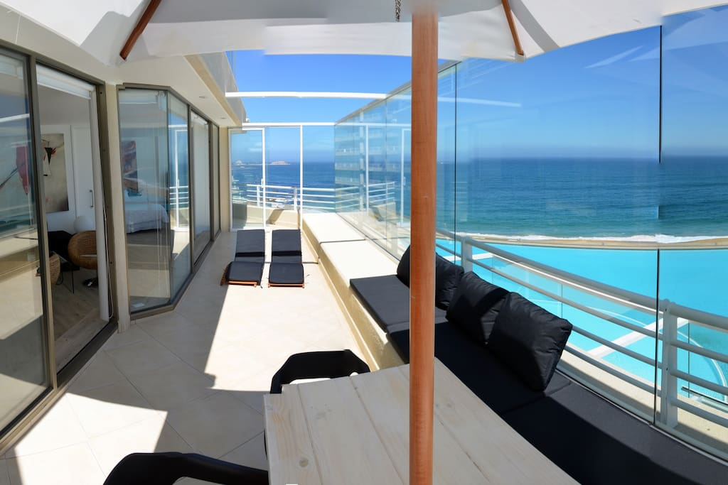 Great ocean view terrace with a dining table and barbecue.