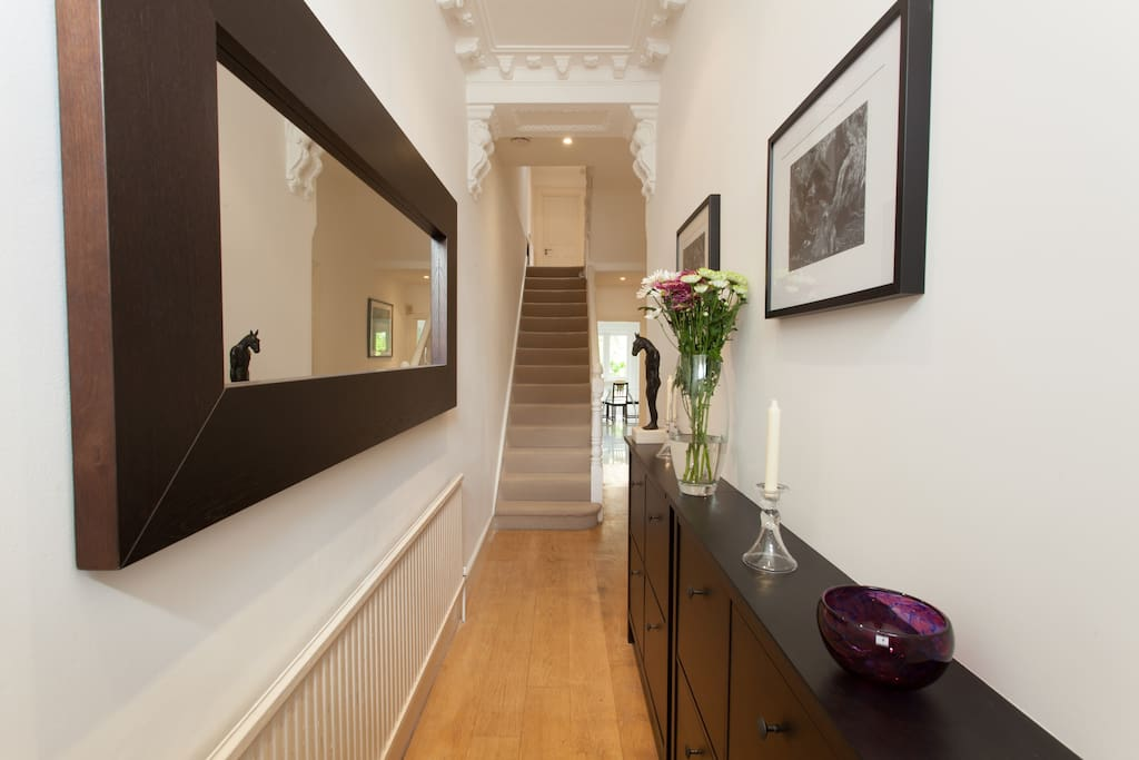 Entrance Hallway, with kitchen visible at the rear (see right corner). A large mirror makes it feel spacious!