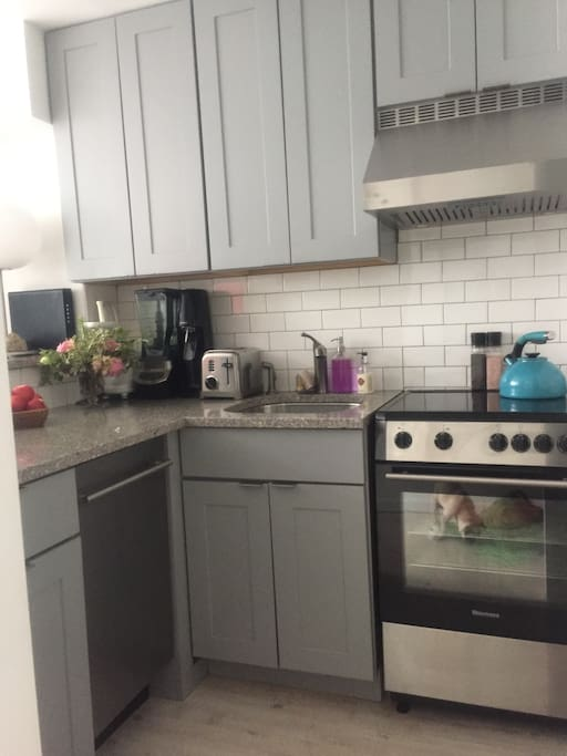 The perfect little kitchen with all new stainless steel appliances, glass top stove, dishwasher, refrigerator, granite countertops and white ceramic tiles makes the best use of space.