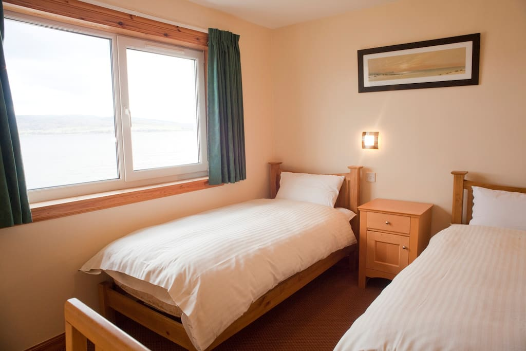 There are three twin rooms the same as this one. All are en-suite with hanging space, individual bedside lights and a dressing table.