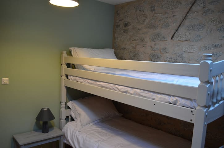 Lots of space in this room with bunk beds.  Even room for a cot too if you have little ones.