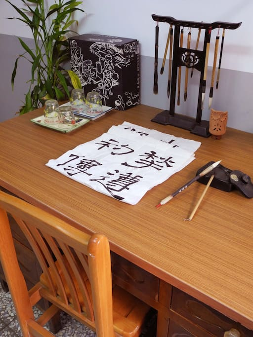 A real full set of calligraphy brushes, calligraphy work done by the hostess.