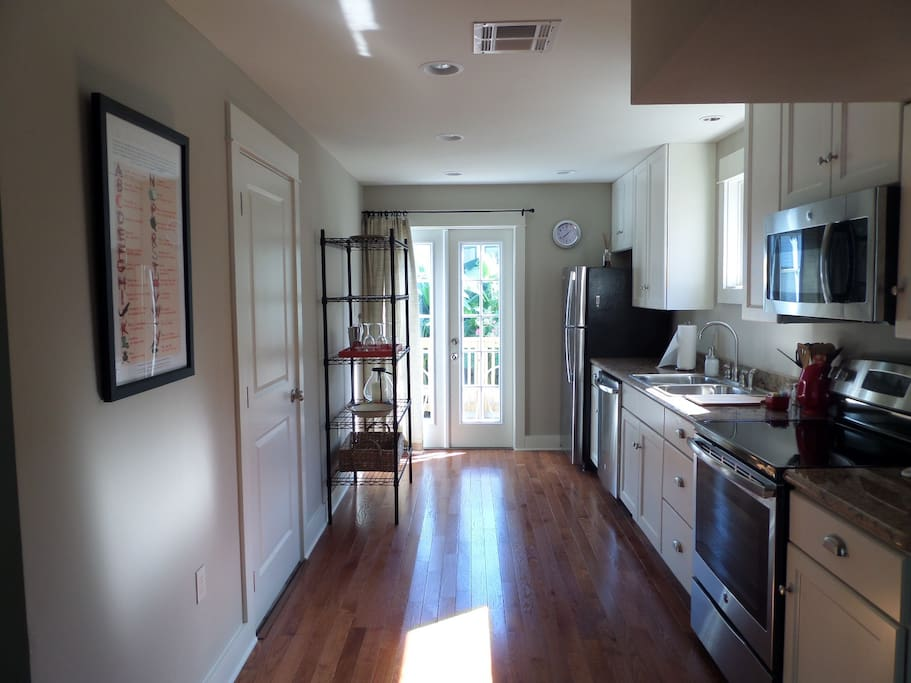 Complete kitchen w/ appliances including dishwasher & microwave.