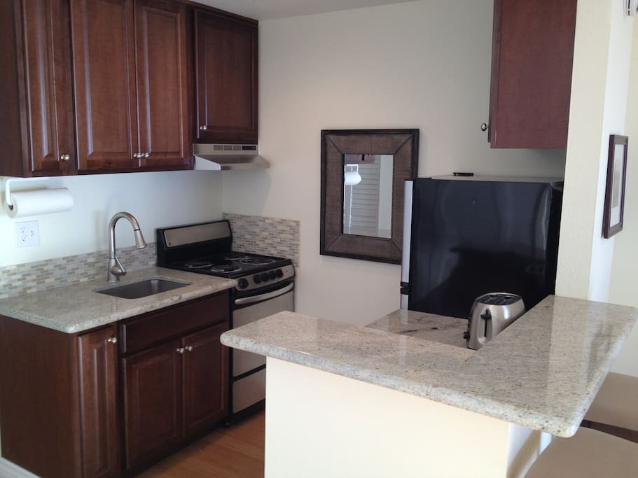 All new maple cabinets, granite countertops, appliances!