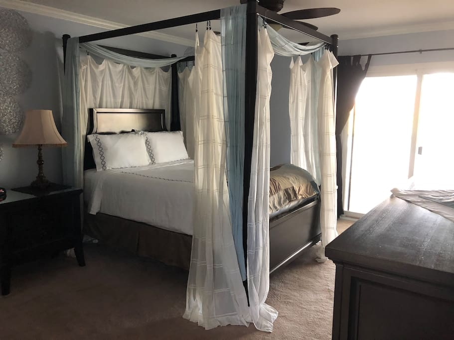 The master suite has direct view of the bayou. Open the sliding doors and enjoy the beautiful view on our covered back porch.