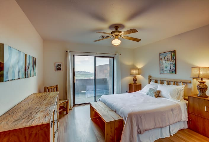 Guest bedroom with more great views and  a queen bed.