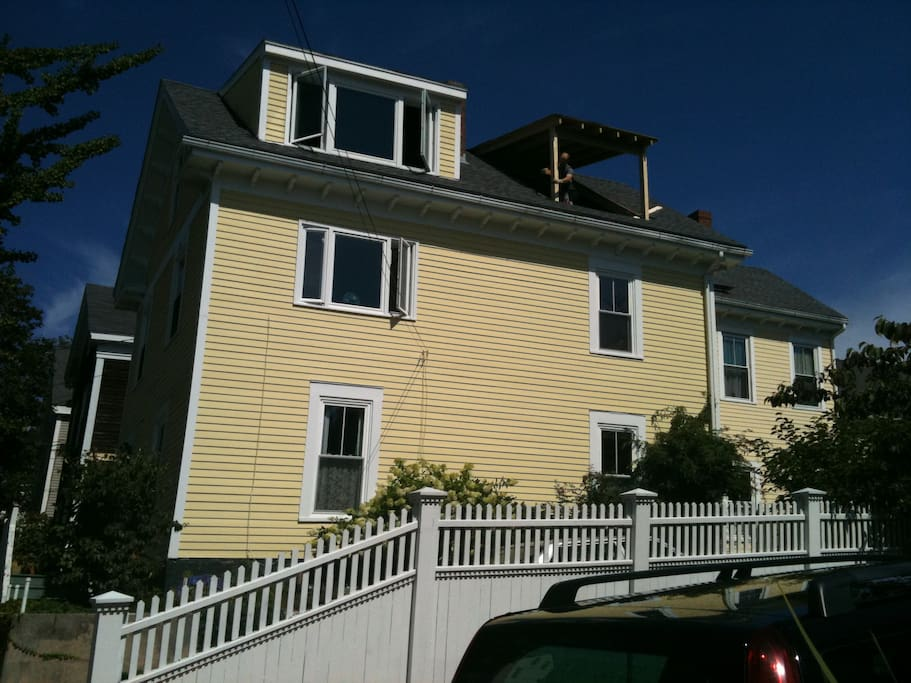 The  house- the third floor dormer has been completed.