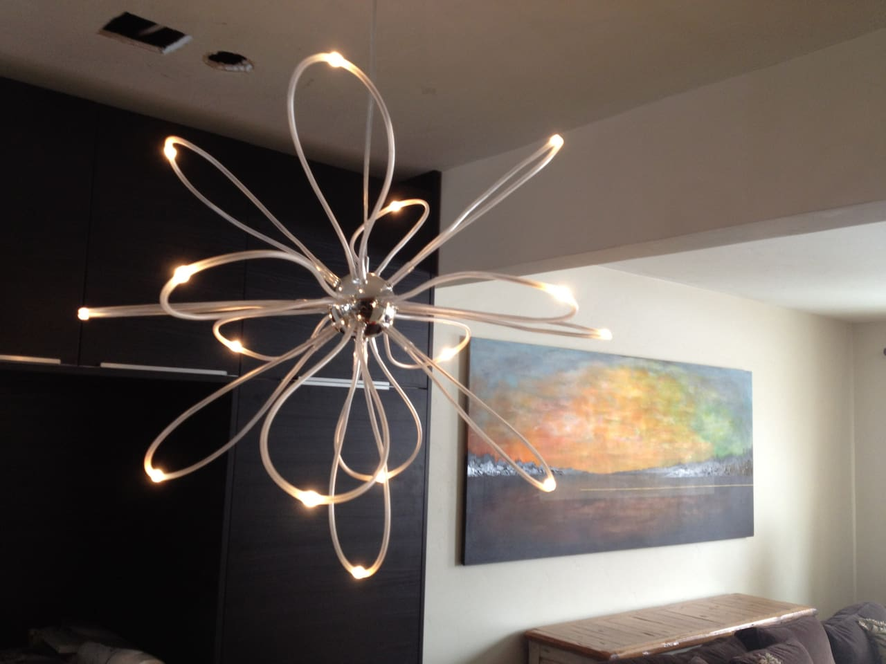 close up of our dining light fixture, looking into the living room