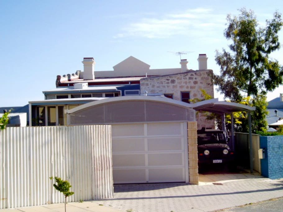 View of the house and the main entry from Little Howard Street plus exclusive use of the garage