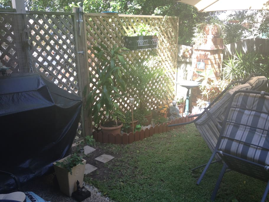 Private back court yard with barbecue and outdoor setting & hammock.