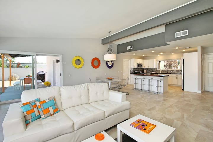Spacious, bright and airy grand room with Italian tile & queen sleeper sofa