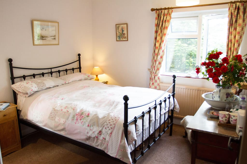 Double Bed with ensuite shower room. Early morning sun can be seen rise over the harbour