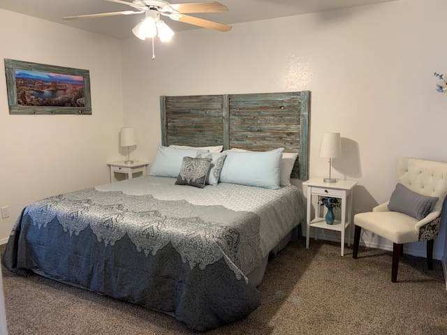 Master Bedroom has a very bright, airy, spa-like feel.  Lorie made the headboard and picture frame to match the decor.  It's very soothing.