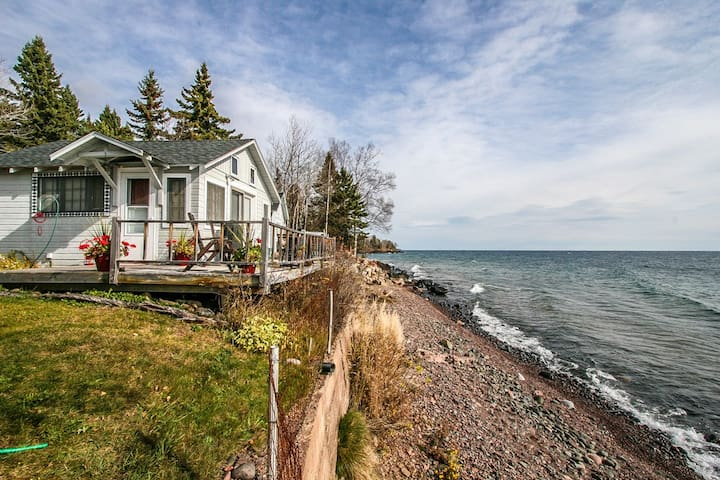 Superior Shores 4 is a unique cottage painted with Cree Indian inspired art with an amazing lake side deck offering hours of inspiration and relaxation