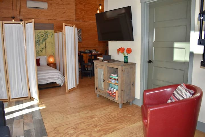 """View from living room looking towards kitchen and lower """"bedroom"""" area.  50"""" HDTV with FREE Netflix/Hulu/Roku"""