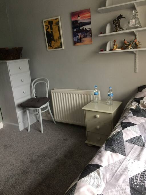 double bed, chest of drawers and bedside cabinet