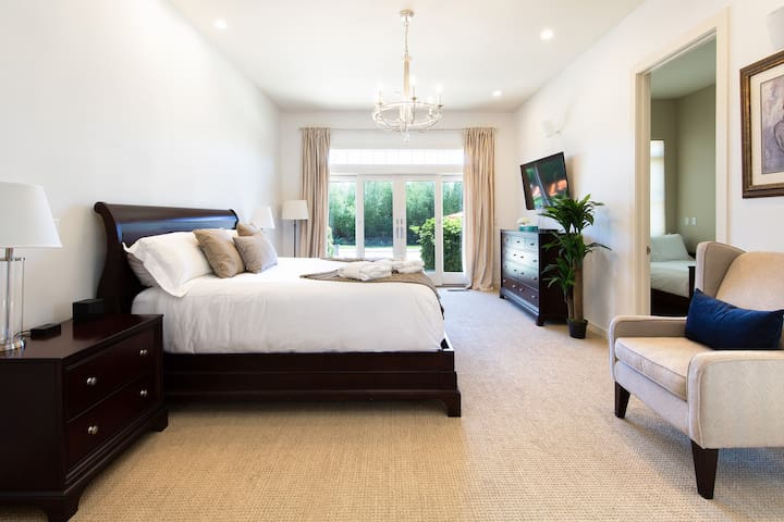 Master Bedroom with Private Deck Leading out to the Pool