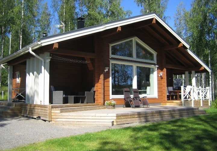 High-end modern log cabin on a lake