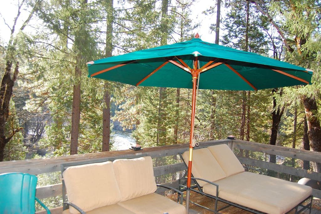 Relax in the double lounge under an umbrella listening to the flow of the South Fork of the Merced River (in background)