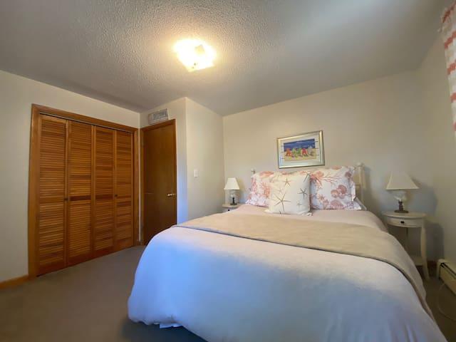 First floor bedroom with a queen bed