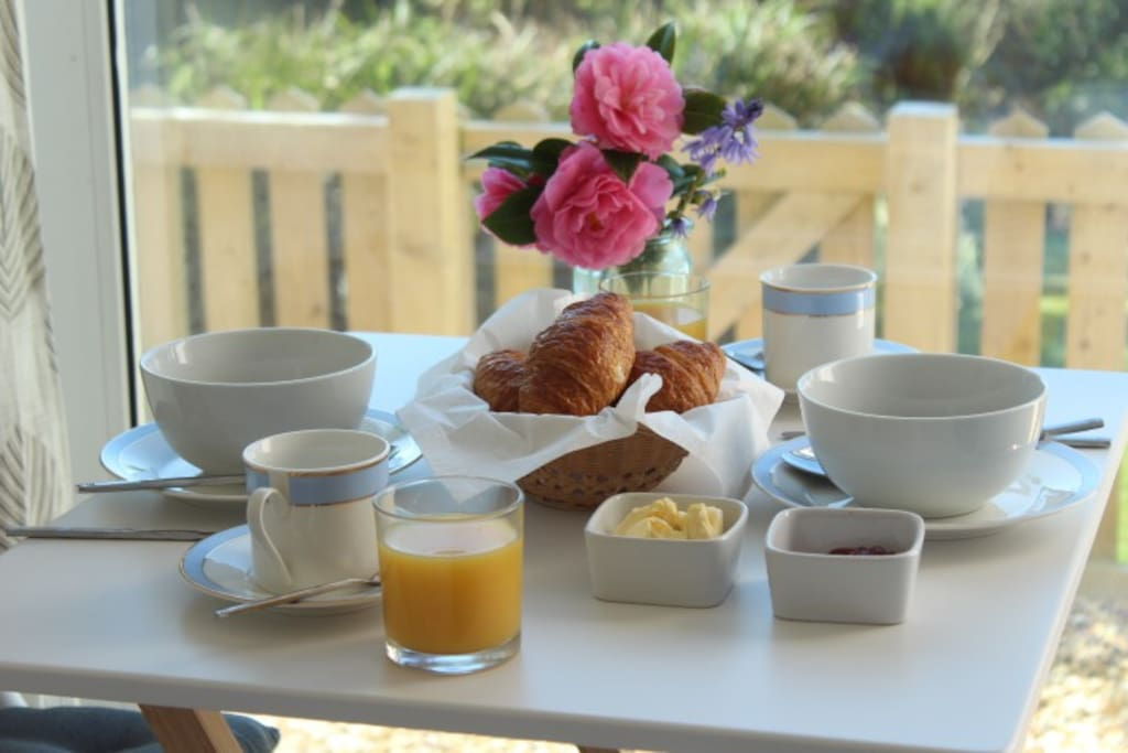A light breakfast of orange juice, cereal , toast or croissants, tea /coffee brought to your room .