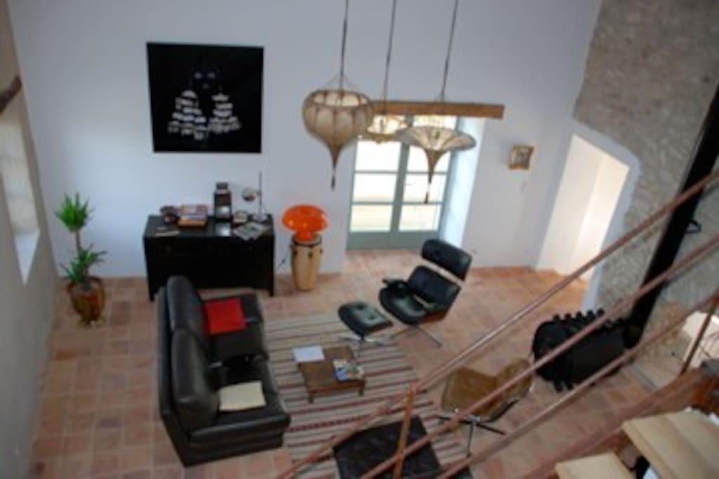 Spacious living room with 20 foot ceilings, exposed wood beams, lots of light