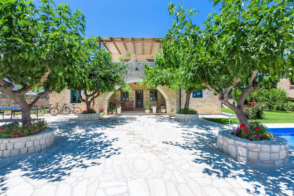 The villa is set in a quiet location with a spacious outdoor area