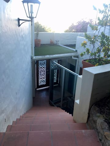 Steps down to the property entrance