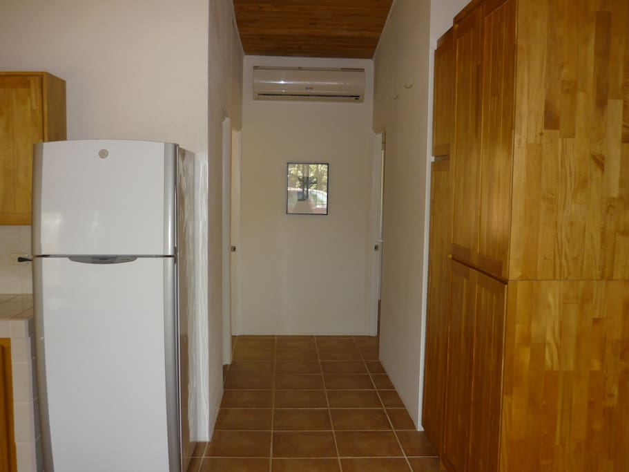 Hall to bedrooms and bath with large strategically placed airconditioner