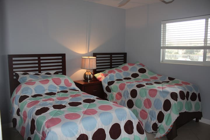 2nd bed room with two twin beds overlooking the boat docking stations !