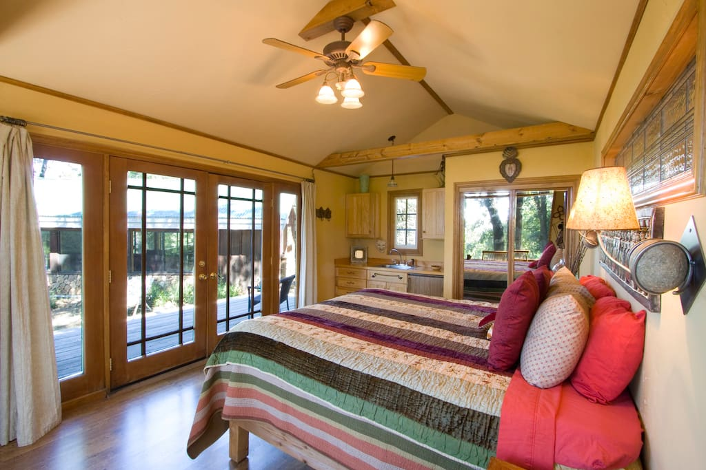 Bed House has french doors that open out to deck and garden.