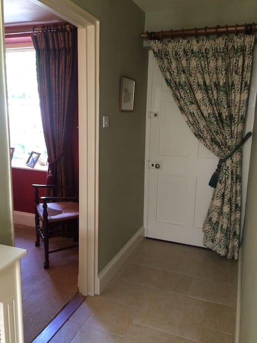 The private entrance leads into the guest quarters which include private dining room and sitting room and stairs up to the bedroom and guests shower room