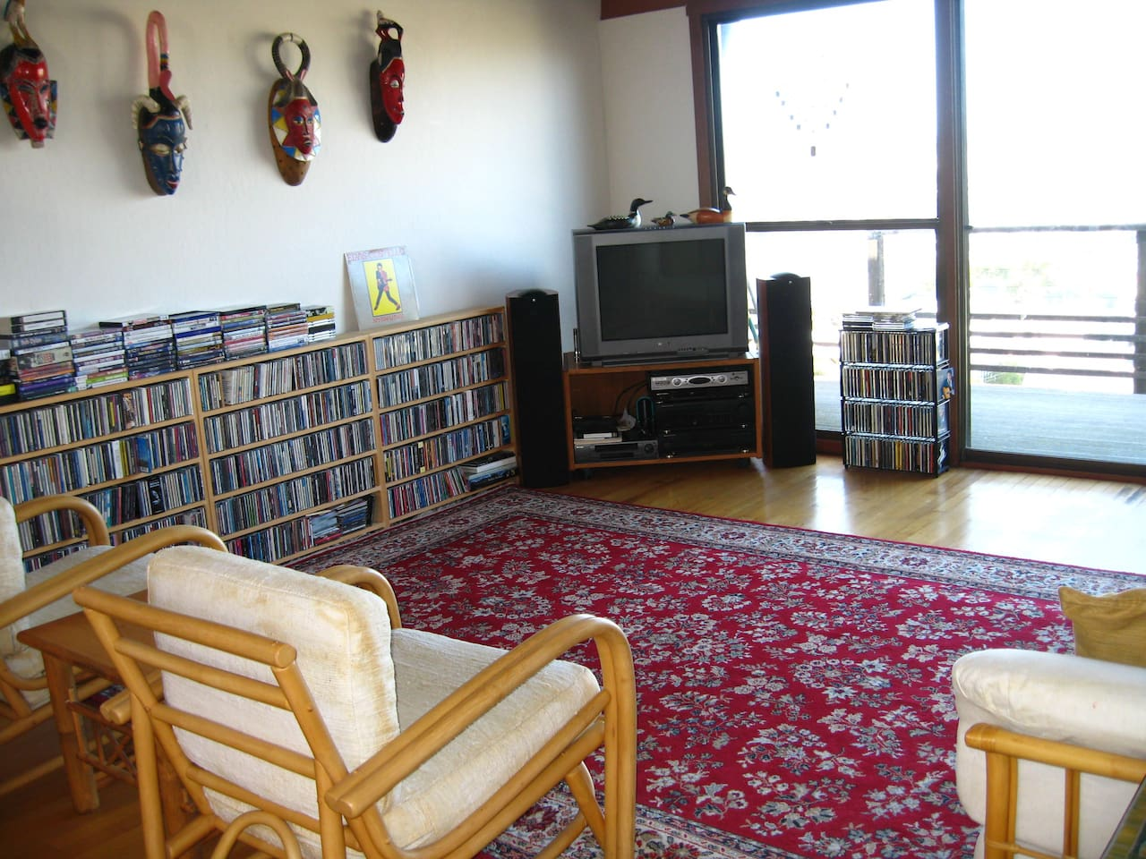 Living Room with lots of music CDs and DVDs.