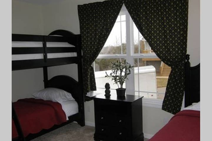 Twin room located in the main floor with one set of bunk beds and a twin bed with a pull out twin trundle bed upon request. Advance notice must be given for the trundle.