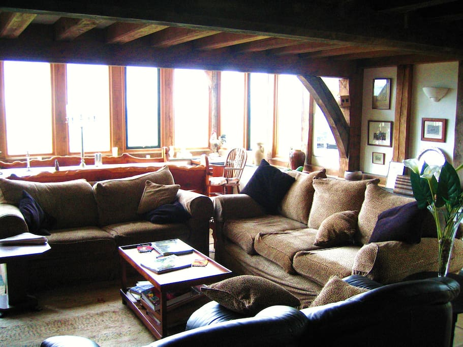 The large, open lounge looking out to the view - great for formal dinner parties on the yew table.