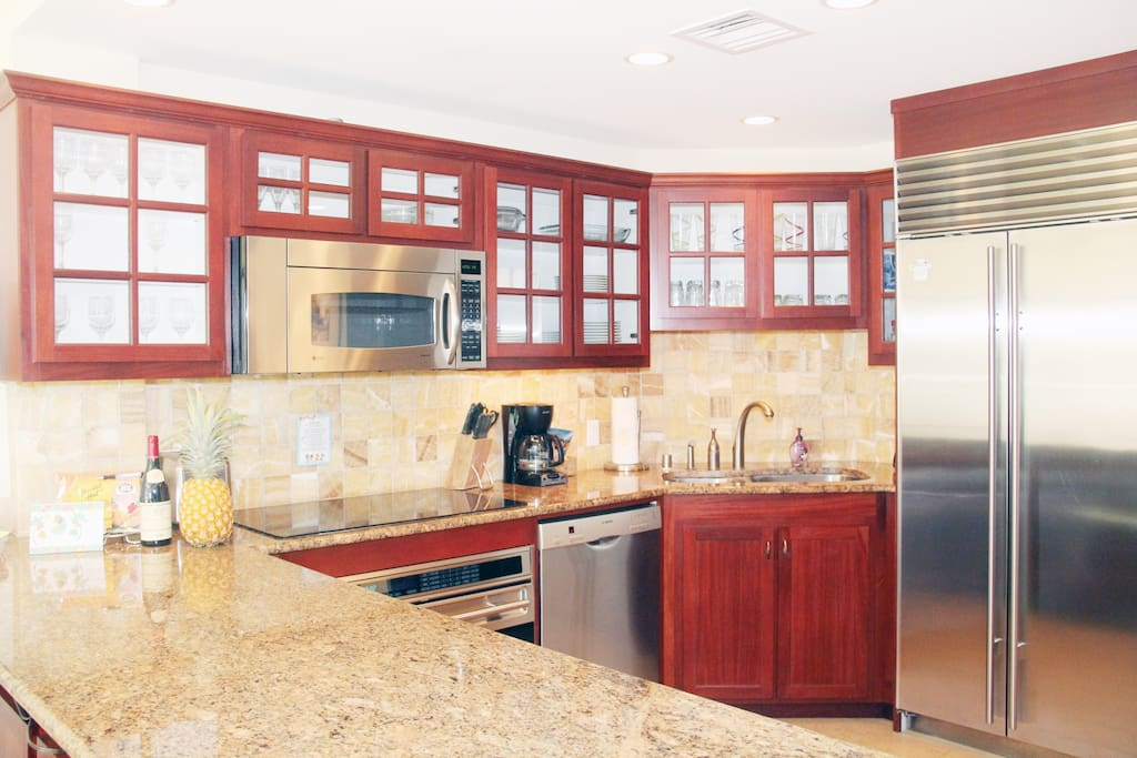 A fully stocked kitchen with sub-zero fridge and top-notch stainless steel appliances