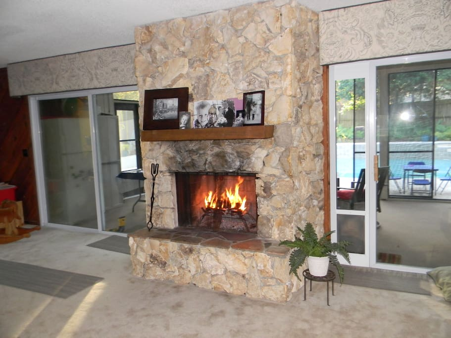 Family room fire place, overlooks the screened in porch and pool