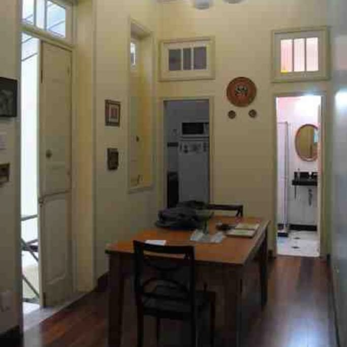 The dining area (old image) showing the bathroom to the right.