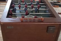Foosball table in optional game room (extra fee applies to game room access, please inquire)