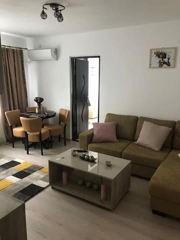 Living room with dining table for four, smart 101 cm Tv, air conditioning system