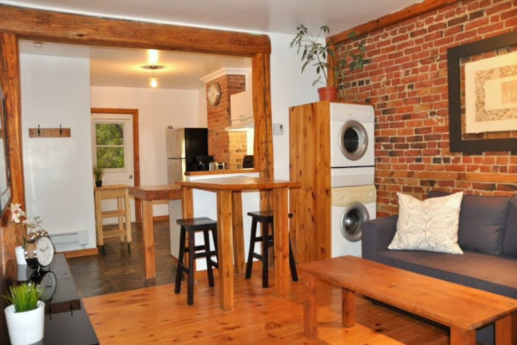 Perfect for 2 to 4 guests. Open space concept. Wooden floors. Brick wall.