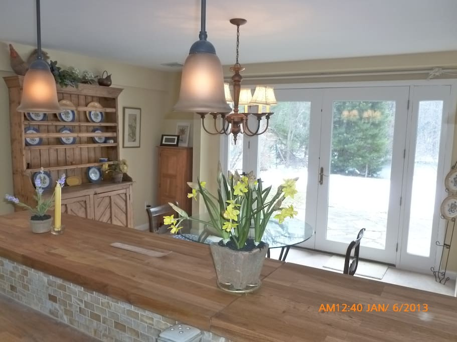Breakfast bar and dining room, french doors to patio