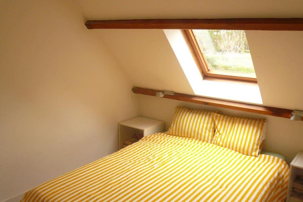 Queen size bed in the second floor