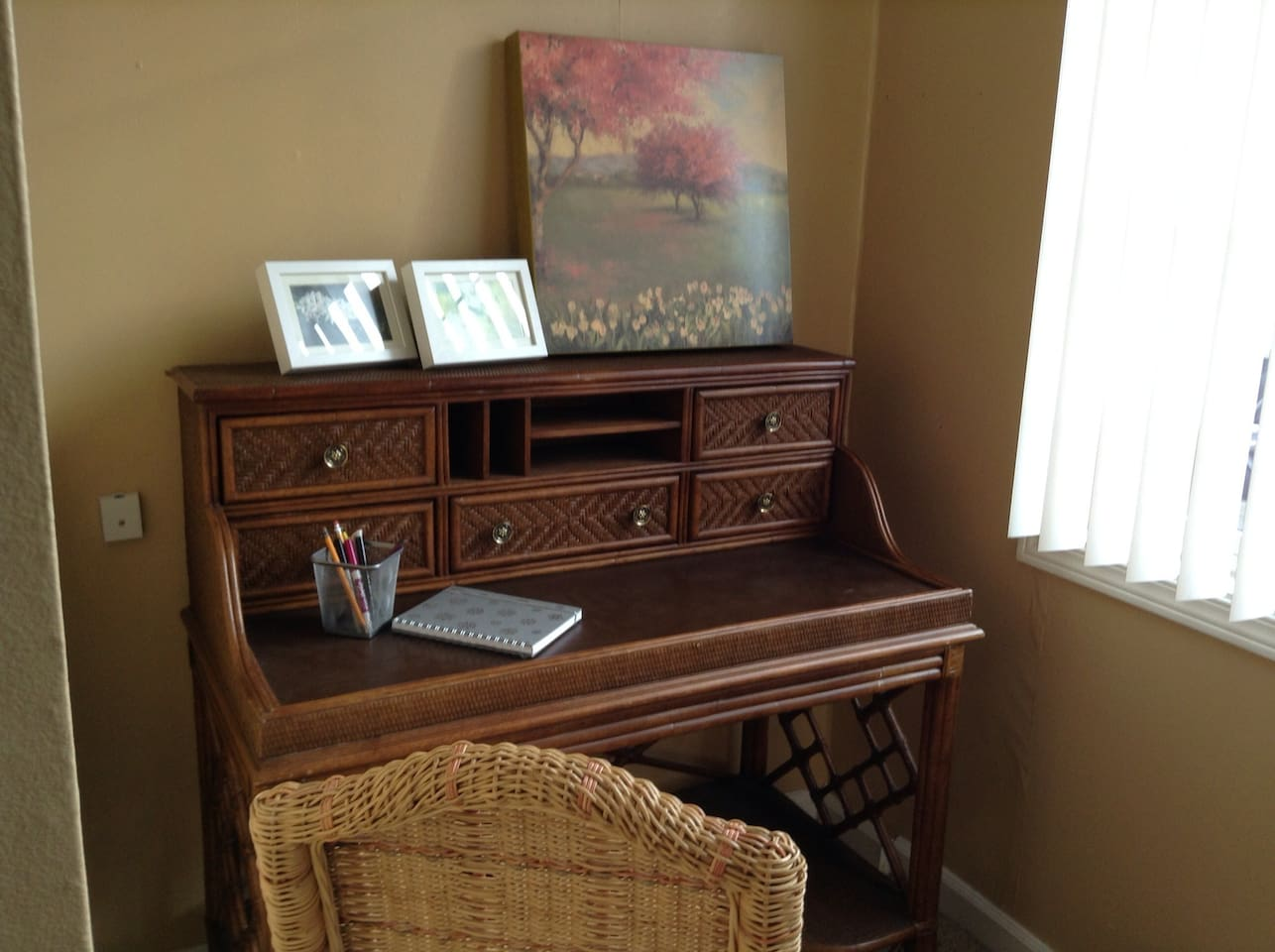 Study and work from the charming wicker desk in the office nook.