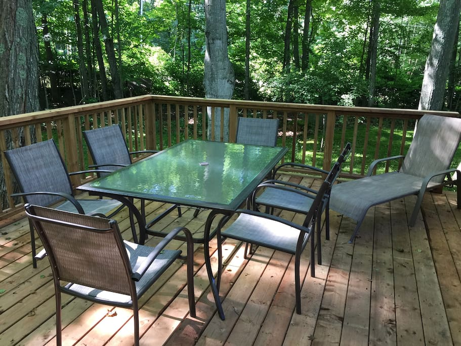 Shady deck off kitchen with natural gas barbecue
