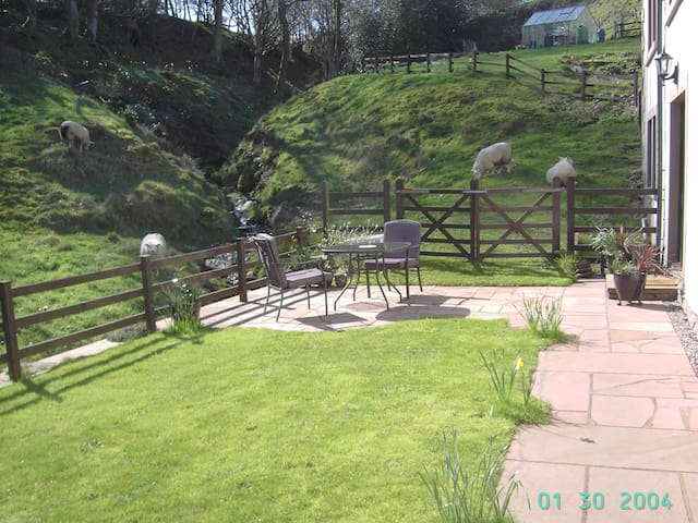Ideal Sun Spot - The place, patio & Garden all benefit when the Sunshines  from Early Morning to Early Evening and being naturally sheltered from the wind. The Bistro table & 3 chairs directly overlook fields, Gill and Waterfall Stream passing by....