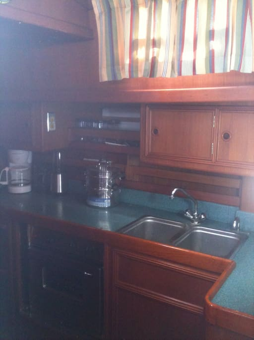 the galley kitchen, in the main salon of the sailboat