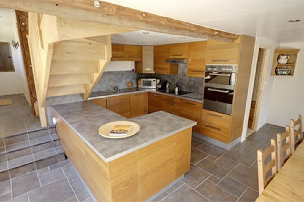 The modern kitchen allows you to cook but stay in touch with everyone else